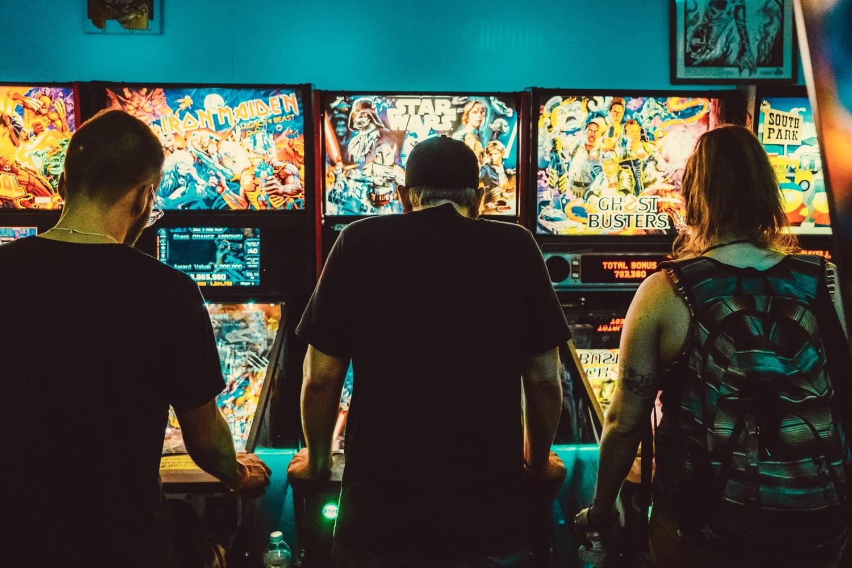 People playing pinball