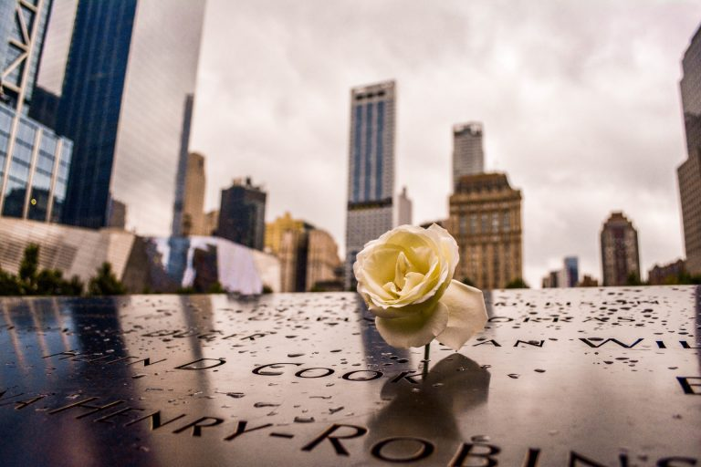 9/11 Memorial with rose on names