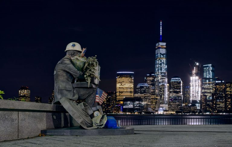 9/11 Memorial statue with Freedom Tower